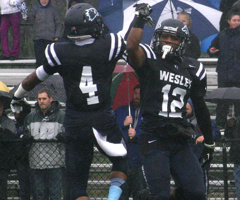 Sean Hopkins and Leon Jones celebrate Hopkins' first-quarter fumble return for a touchdown. (Wesley athletics photo)